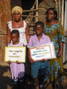 Children with posters --  Irene, Ntamuhira, with the headmistress Ms. Juliet and Madam Kabugho