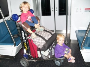 Since our stroller didn't make it, we improvised and loaded up a luggage cart... and since we had a bit of time before our flight in Miami, we road the train.  A lot.