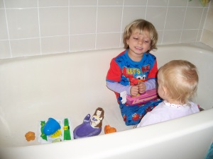 They were so excited to take a bath the morning after we got there (We don't have a tub) - the waaaaaay too early morning - that they climbed in pajamas and all.