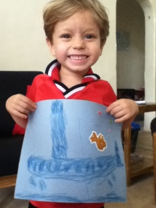 Judah proudly showing the plane he drew. (Actually, Chris and I were pretty impressed with it ourselves!)